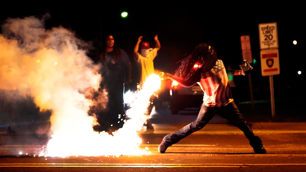 3034842-poster-p-1-3-things-that-turned-this-photograph-into-a-ferguson-icon