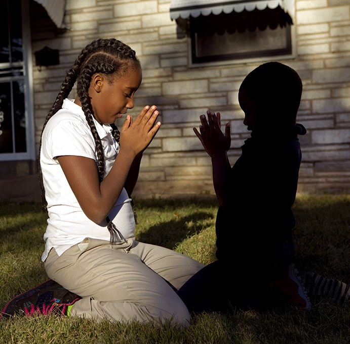 """Lord help us make it through this day,"" says Destiny Sonnier, 9, who drops to her knees after performing a cartwheel routine with her cousin Anthony Murry, 6, on Wednesday, Oc.14  2015.  ""We pray so we won't get shot,"" said Destiny, who has lost her father to gun violence in April 2013 along with her friend Jamyla's Bolden and cousin her cousin Mansur Mansur Ball-Bey, the same week in August  in 2015.  Photo by Laurie Skrivan, lskrivan@post-dispatch.com"